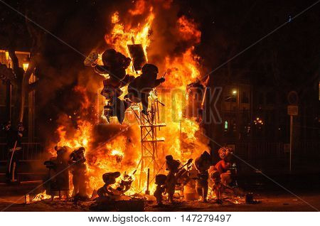 VALENCIA, SPAIN - MARCH 19, 2015: Colorful paper mache burning figures in the Las Fallas Festival in Valencia Spain