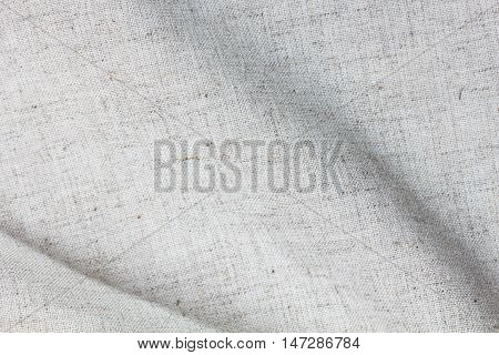 Flax woven texture pattern background beige cream color tone. Eco friendly organic flax cloth fabric textile backdrop
