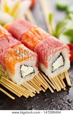 Salmon and Tuna Maki Sushi - Roll made of Cream Cheese and Shrimp (ebi) inside. Fresh Salmon and Tuna outside