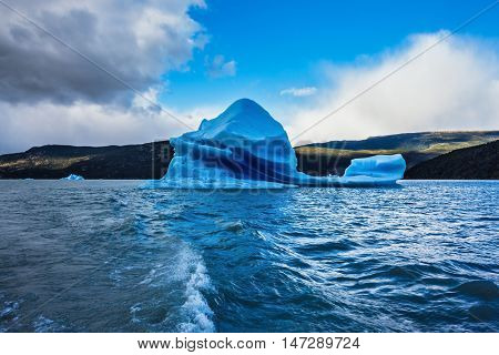 The huge icebergs and ice floes which broke away from coastal glacier.  Grey Lake in the national park Torres del Paine, Chile