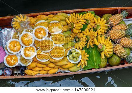 Fruits on the boat at Damnoen Saduak floating market in Ratchaburi near Bangkok Thailand
