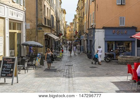 AIX EN PROVENCE,FRANCE-AUGUST,2016:People strolling down the typical streets of Aix-en-Provence during a summer day.