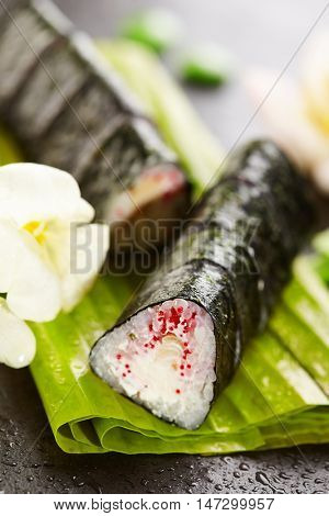 Maki Sushi - Roll made of Tobiko (flying fish caviar), Cream Cheese and Tamago (japanese omelet) inside, Nori outside