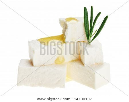 Feta Cheese Cubes With Rosemary Twig And Oil Drops