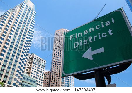 Detail of Boston skyline and traffic sign with the inscription Financial District