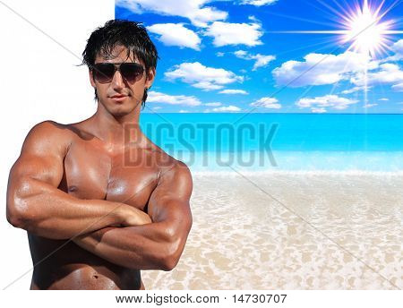 Handsome man  with ideal beach landscape  - Clipping path on the man easy to cut him out - perfect for travel agencies