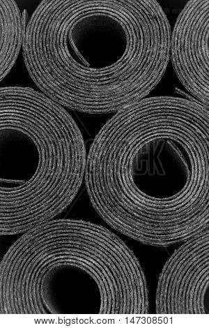 Closeup of Rolls of new black roofing felt or bitumen