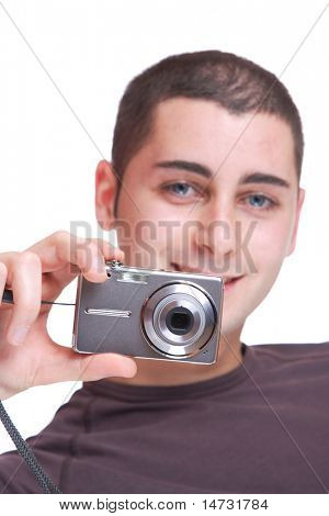 Young photographer over white background - selective focus