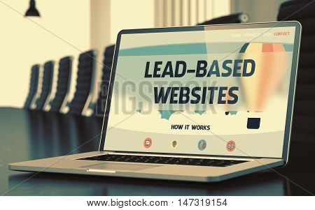 Modern Conference Hall with Laptop Showing Landing Page with Text Lead-based Websites. Closeup View. Blurred Image. Selective focus. 3D Render.