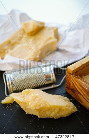 Parmesan cheese. Grated Parmesan cheese and Olive Wood Parmesan Cheese Grater.