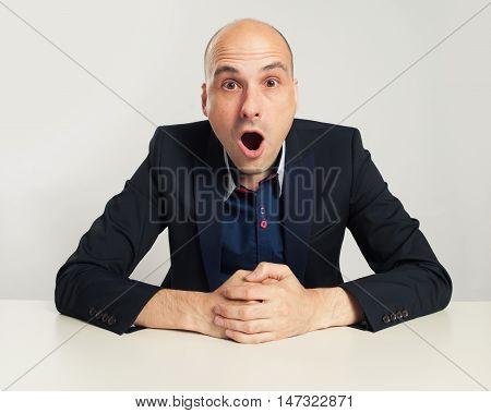 Shocked Bald Businessman