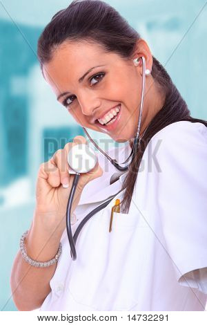 Sexy beautiful female doctor in light medical environment
