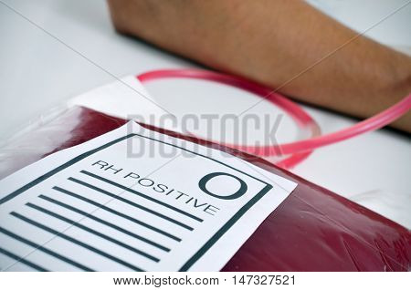 closeup of a blood bag with a label with the text O RH positive on the doctors office