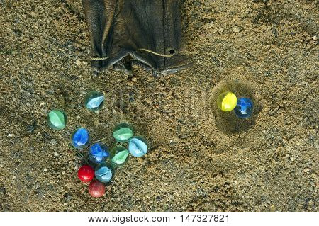 Glass marbles lying on ground . Differential focus