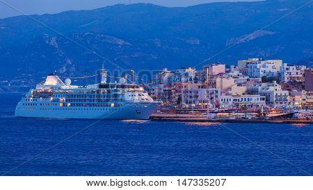 Agios Nikolaos City And Cruse Ship At Night, Crete, Greece