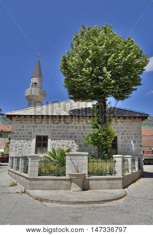 A mosque and minaret in Trebinje Republika Srpska Bosnia and Herzegovina. poster