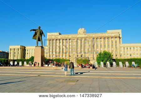 ST PETERSBURG RUSSIA - MAY 23 2015. Monument to Lenin on the background of the House of Soviets at Moscow Square in summer sunny evening in St Petersburg Russia