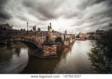View of Charles Bridge and Hradcany in Prague Europe.