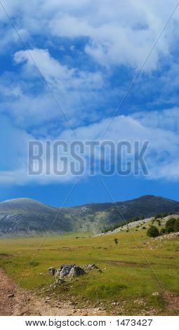 Dinara Mountain Over Blue Sky 3