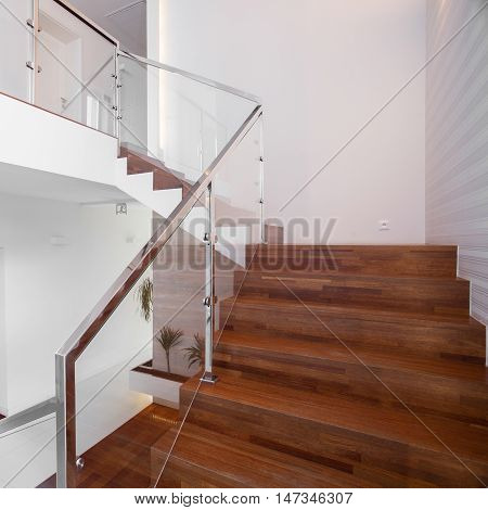 Wooden stairs with solid and elegant balustrade