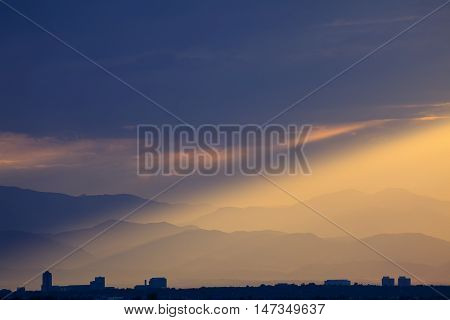 Dramatic Sunset on Colorado Front Range with Mountains and City Buildings
