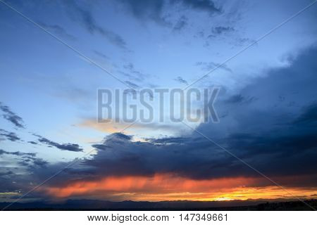 Dramatic Storm Clouds at Sunset over Mountain Range
