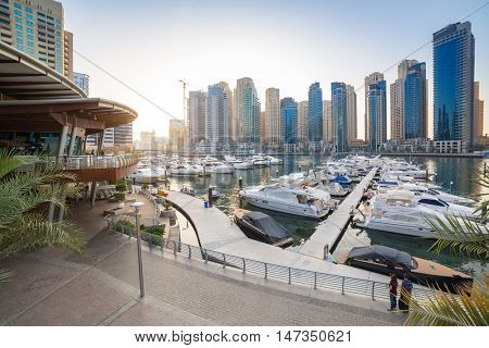 DUBAI, UAE - MARCH 30, 2014: City scenery of Dubai Marina, UAE. Dubai Marina is a district in Dubai with artificial canal skyscrapers who accommodates more than 120,000 people.