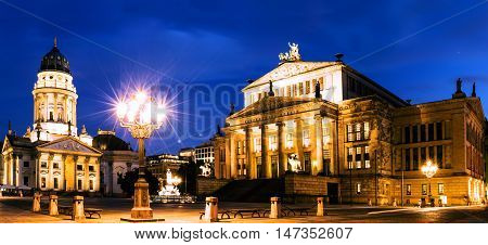 Night panoramic. Gendarmenmarkt square with German Cathedral, Berlin Mitte district