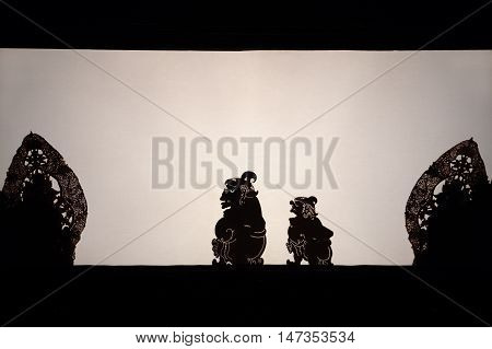 Bali Indonesia - 27 June 2016: Black shadow silhouette of old traditional puppets of Bali Island - Wayang Kulit. Culture religion Arts festival of Balinese and Indonesian people. Travel background