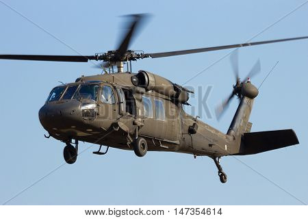 GRAVE NETHERLANDS - SEP 17 2014: American Army Blackhawk helicopter taking off.