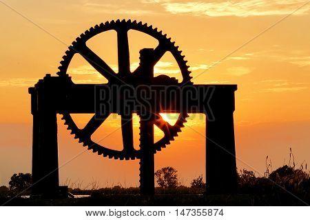 Sluice wheel at Startops End reservoir at sunset