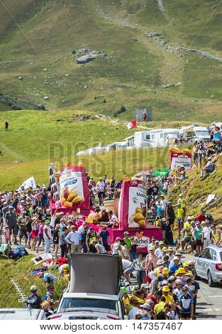 Col du Glandon France - July 23 2015: St. Michel Madeleines caravan during the passing of the Publicity Caravan on Col du Glandon in Alps during the stage 18 of Le Tour de France 2015.