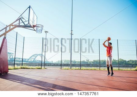 African american basketball player showing his skills.