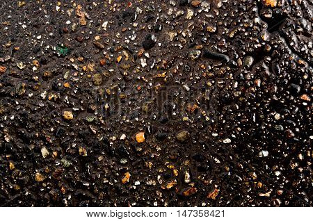 Asphalt, asphalt texture, real asphalt texture background, scabrous asphalt background, grainy street detail gray textured background, seamless asphalt background, closeup, wet road, wet asphalt