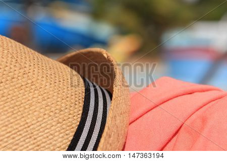Straw Trilby Hat On Sunny Pool Side With Pink Shirt