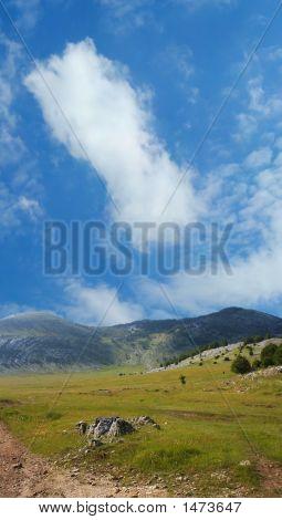 Dinara Mountain Over Blue Sky 2