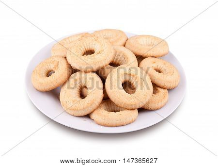 Tea cookies on a plate isolated on white background.