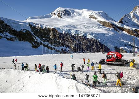 SWITZERLAND, SAAS-FEE, DECEMBER, 26, 2015 - View from above on Felskinn snow sports routes with wide glacial slopes and natural snow. Varied routes for freeriders and snowboarders at an altitude of 2550 m near Saas-Fee, Switzerland.