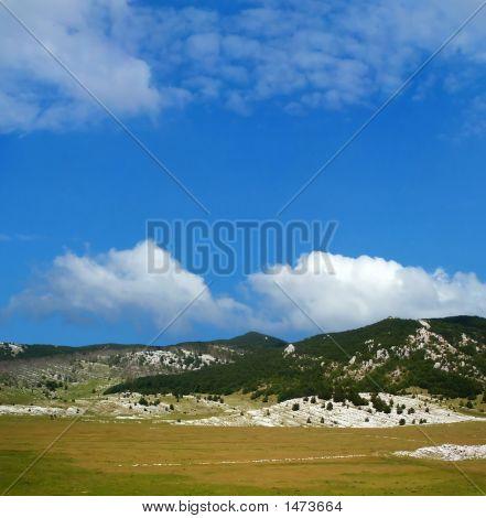 Dinara Mountain Over Blue Sky 9