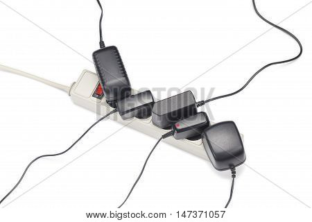 Many plugs plugged in extension cord isolated on white