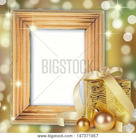 golden gifts box with brocade ribbon and Christmas balls isolated on white
