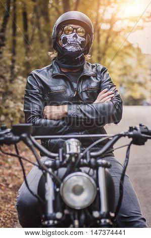 Biker Man Sitting On His Motorcycle