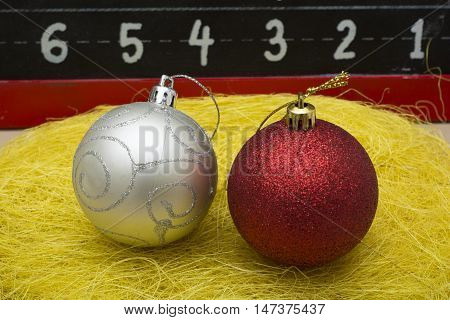 Two Chirstmas 's ball close up on yellow thread.