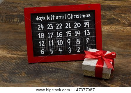 Chirstmas Countdown numbers on chalk board with gift box.