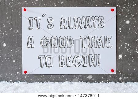 Label With English Quote It Is Always A Godd Time To Begin. Urban And Modern Cement Wall As Background On Snow With Snowflakes.