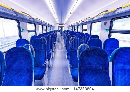 Interior of the empty passenger carriage of the train.