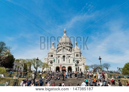 Paris France - May 08 2016: Unidentified tourists visiting Sacre Coeur Cathedral on Montmartre. Sacre Coeur Cathedral is a Roman Catholic church in Paris France.
