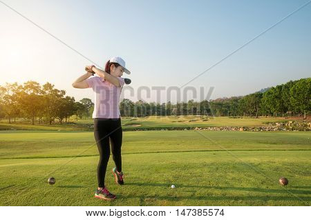 Asian woman golf hit sweeping golf course in the summer. Golf sport concept.