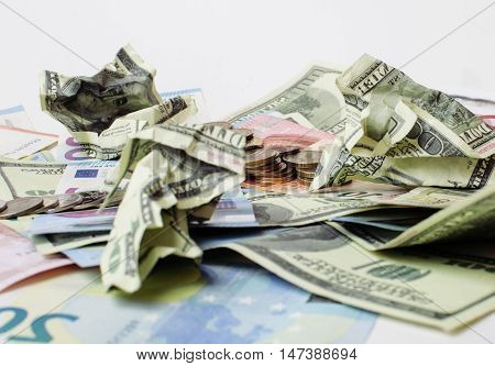 Cash on table isolated: dollars, euro, rubl broken money. All in mess, global crisis concept, dollar rules world