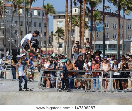 Venice Beach, California, 9/10/16--Skateboarder Steve Martinez launches high in the air at Venice Beach Skate Park while crowd watches. Thousands of tourists flock to the Venice Beach Boardwalk every weekend.